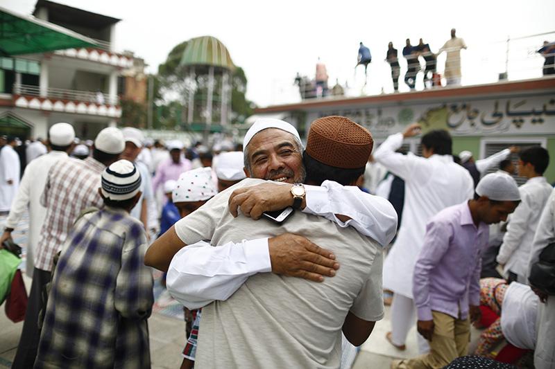 Nepali Muslims embrace each other after offering prayers during Eid al-Fitr festival at Jame Mosque, in Kathmandu, on Saturday, June 16, 2018. Photo: Skanda Gautam