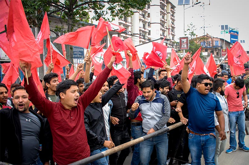 Nepal Students Union, the student wing of main opposition Nepali Congress, staging a demonstration to protest the hike in prices of petroleum products at Mitrapark, Kathmandu, on Friday, June 8, 2018. Photo: Naresh Shrestha/THT