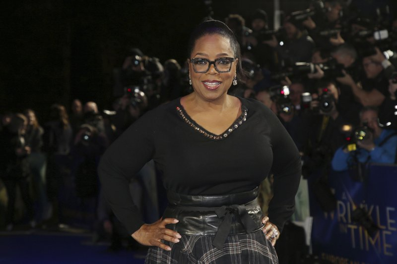 File - In this photo, actress Oprah Winfrey poses for photographers upon arrival at the premiere of the film u2018A Wrinkle In Timeu2019 in London on March 13, 2018. Photo: AP