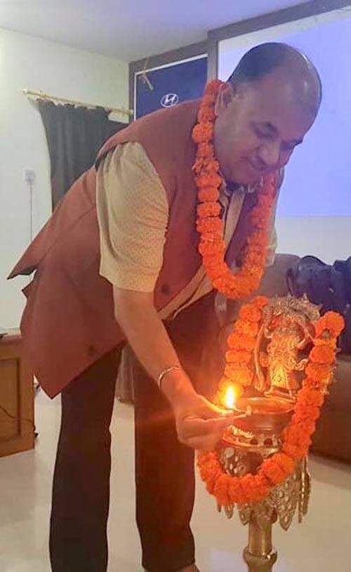 This undated image shows Pokhara Metropolis' Senior Officer Om Raj Paudel lighting a panas. Photo: Rishi Ram Baral
