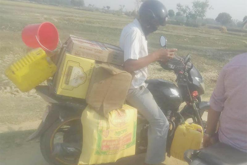 A man ferrying liquor on a motorcycle to India in the border area of Rajbiraj, Saptari, on Tuesday, JUne 12, 2018. Photo: THT