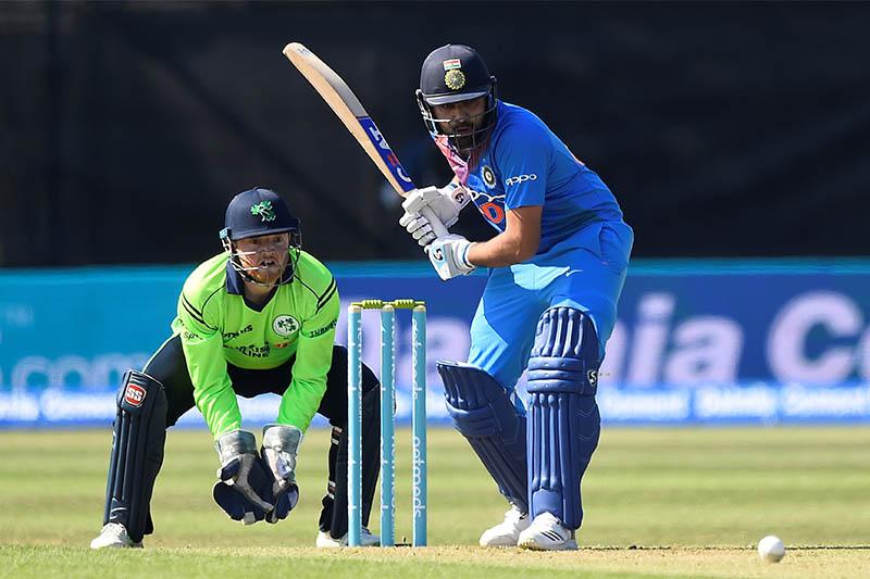 India's Sharma Rohit in action as Ireland's Stuart Poynter looks on. Photo: Reuters