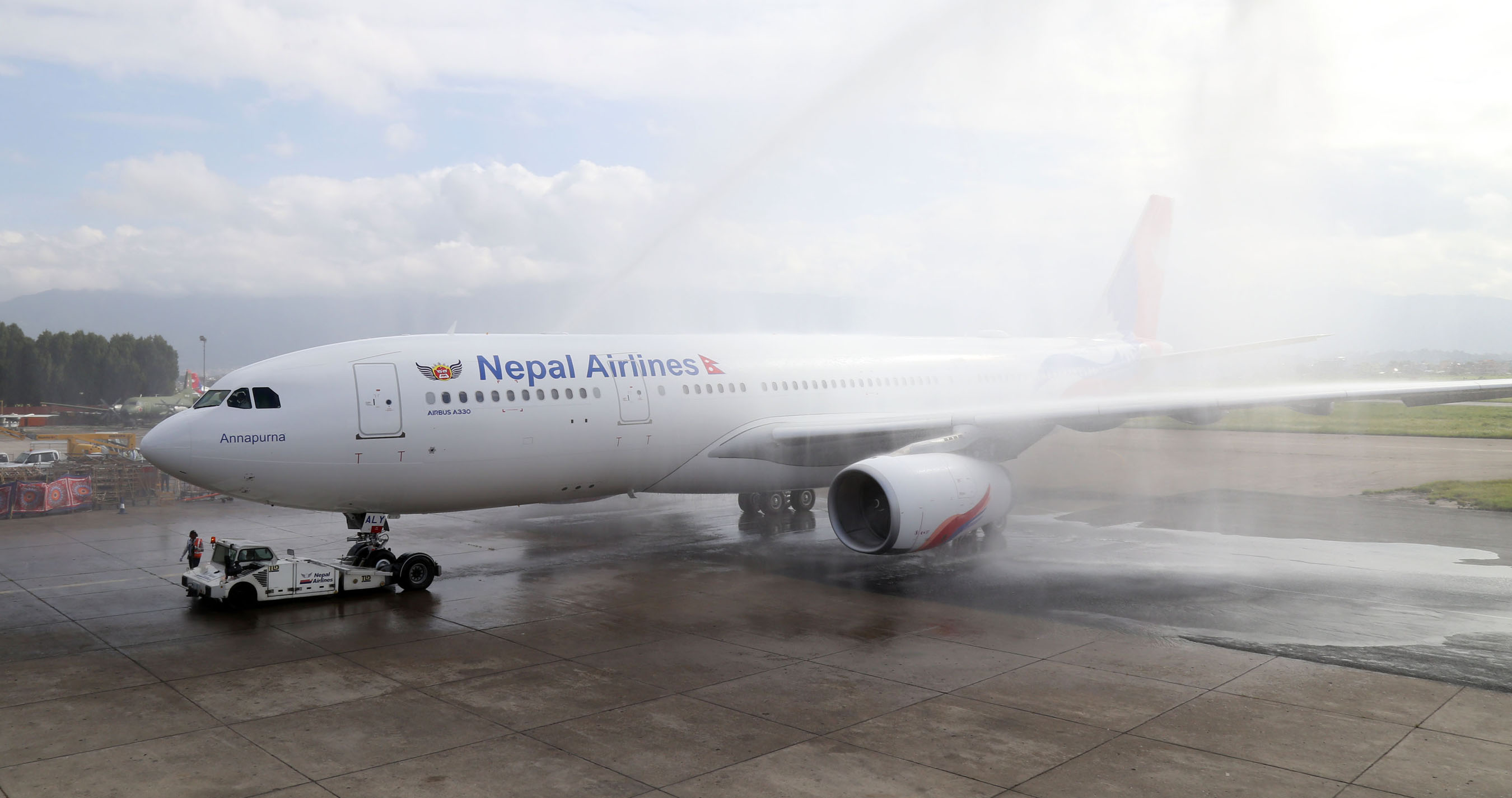 A new first long-range Airbus A330-200 aircraft of Nepal Airlines Corporation is welcomed by a traditional water cannon salute at Tribhuvan International Airport in Kathmandu, on Thursday, June 28, 2018. Rolls-Royce Trent 700 engines power the new aircraft. Photo: Skanda Gautam/THT