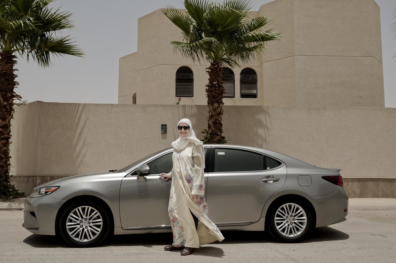 In this photo, Ammal Farahat, who has signed up to be a driver for Careem, a regional ride-hailing service that is a competitor to Uber, poses for a photograph next to her car on a street in Riyadh, Saudi Arabia on Sunday, June 24, 2018 . Photo: AP