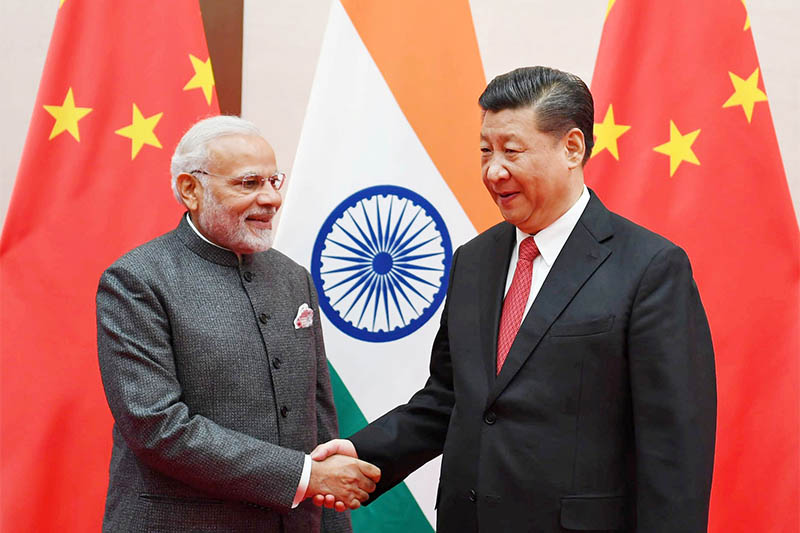 India's Prime Minister Narendra Modi shakes hands with Chinese President Xi Jinping during the 18th Shanghai Cooperation Organisation (SCO) Summit in Qingdao, China, June 9, 2018. Photo: Reuters