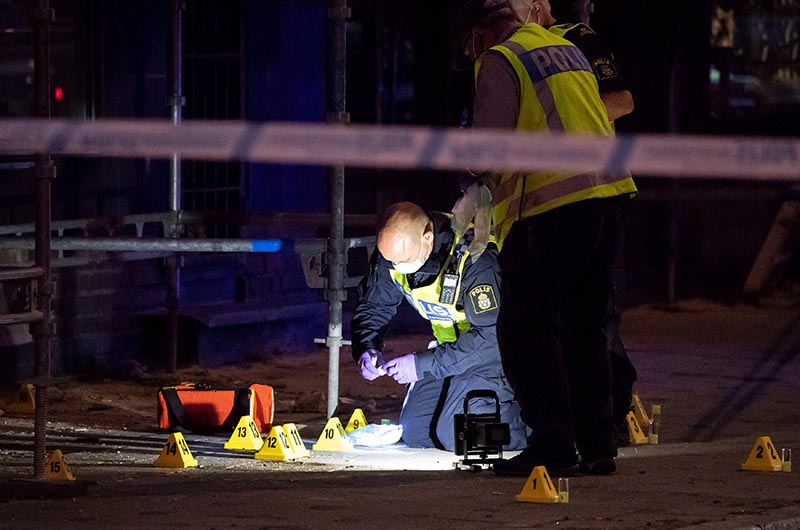 Police forensics investigate the scene after people were shot and injured outside an Internet cafe on Drottninggatan street in central Malmo, southern Sweden, on June 18, 2018.  Photo: Reuters