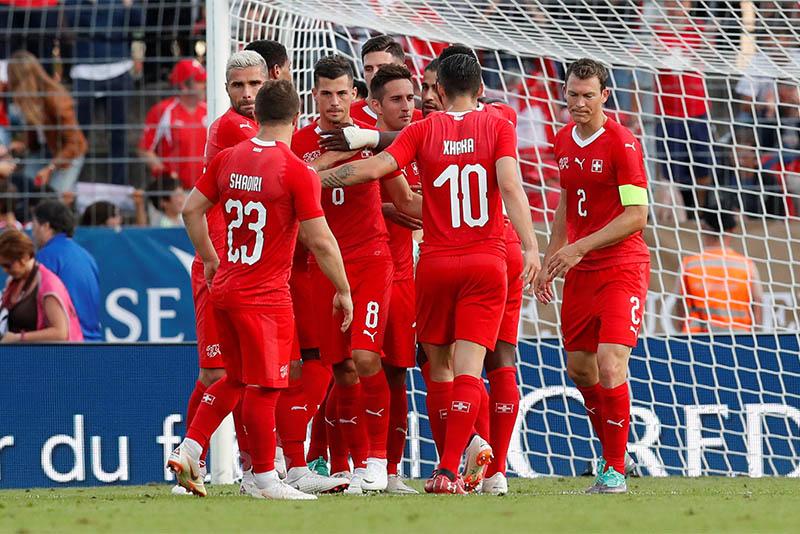 Switzerland's Ricardo Rodriguez celebrates scoring their first goal with teammates. Photo: Reuters