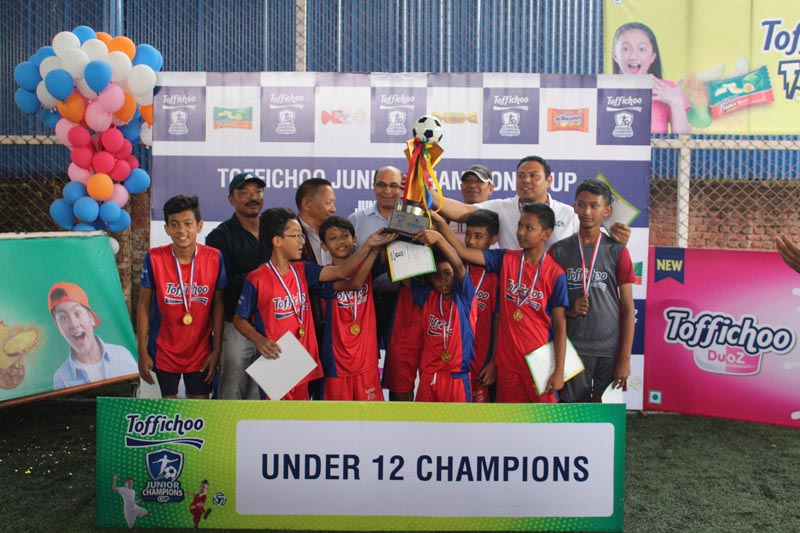 Rato Bangala team members with officials after winning the U-12 title of the Toffichoo Junior Champions Cup in Kathmandu on Friday, June 22, 2018. Photo: THT