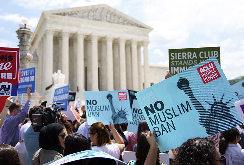 Protesters hold up signs and call out against the Supreme Court ruling upholding President Donald Trump's travel ban, outside the Supreme Court, in Washington, on Tuesday, June 26, 2018. Photo: AP