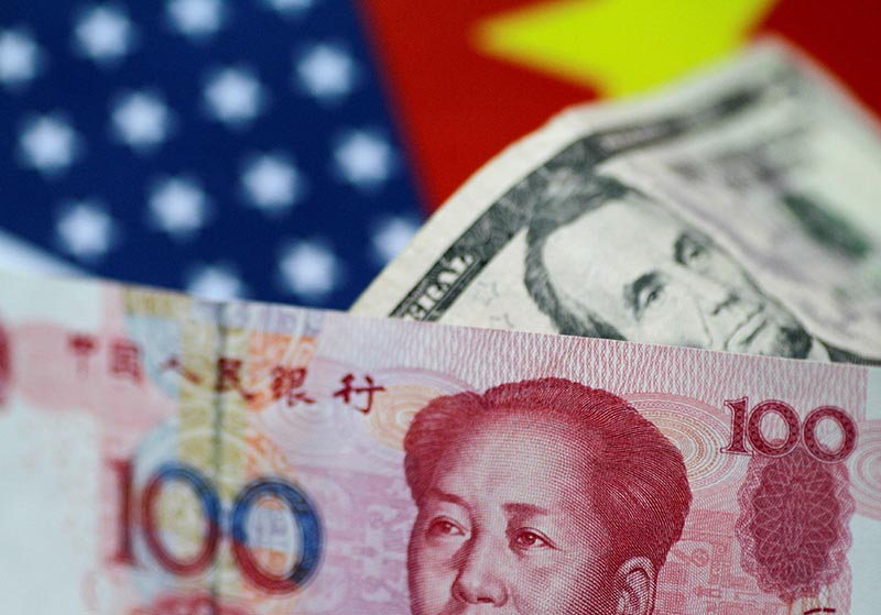 US Dollar and China Yuan notes are seen in this picture illustration June 2, 2017. Photo: Reuters/ File