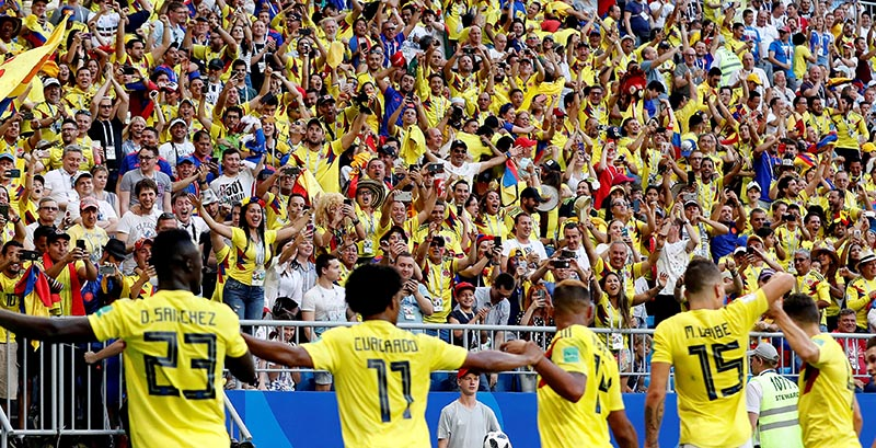 Colombia players celebrate in front of fans after Yerry Mina scores their first goal during the World Cup Group H match between Senegal and Colombia, at Samara Arena, in Samara, Russia, on June 28, 2018. Photo: Reuters