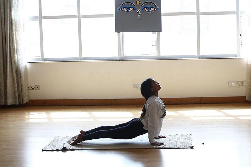 A Nepali woman performs yoga during the International Day of Yoga, in Kathmandu, on Thursday, June 21, 2018. Photo: Skanda Gautam