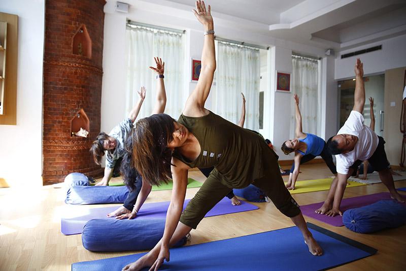 Nepali people take part in a yoga session on the International Day of Yoga, in Kathmandu, on Thursday, June 21, 2018. Photo: Skanda Gautam