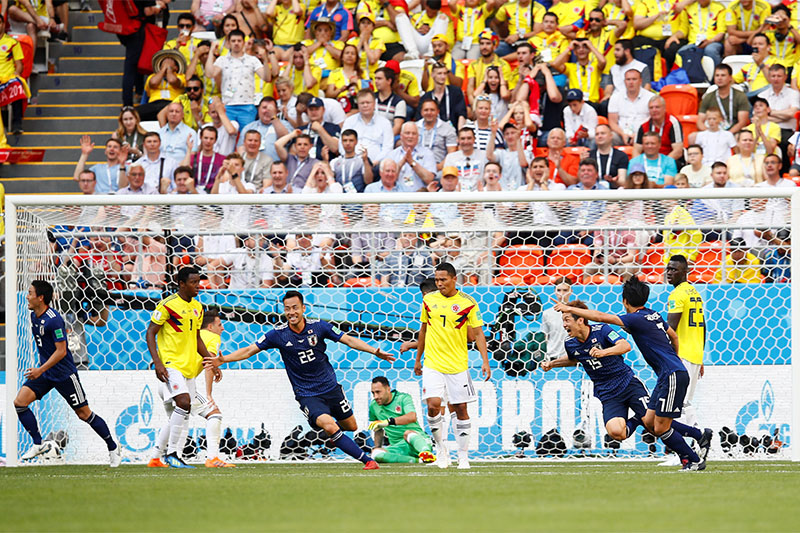 Japan's Yuya Osako celebrates scoring their second goal. Photo: Reuters