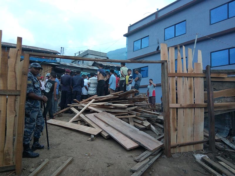 Police, Armed Police Force, and locals are seen along with banned wood during a raid in Pathibhara Furniture Industry, in Phidim Municipality of Panchthar, on Monday, June 4, 2018. Photo: Laxmi Gautam
