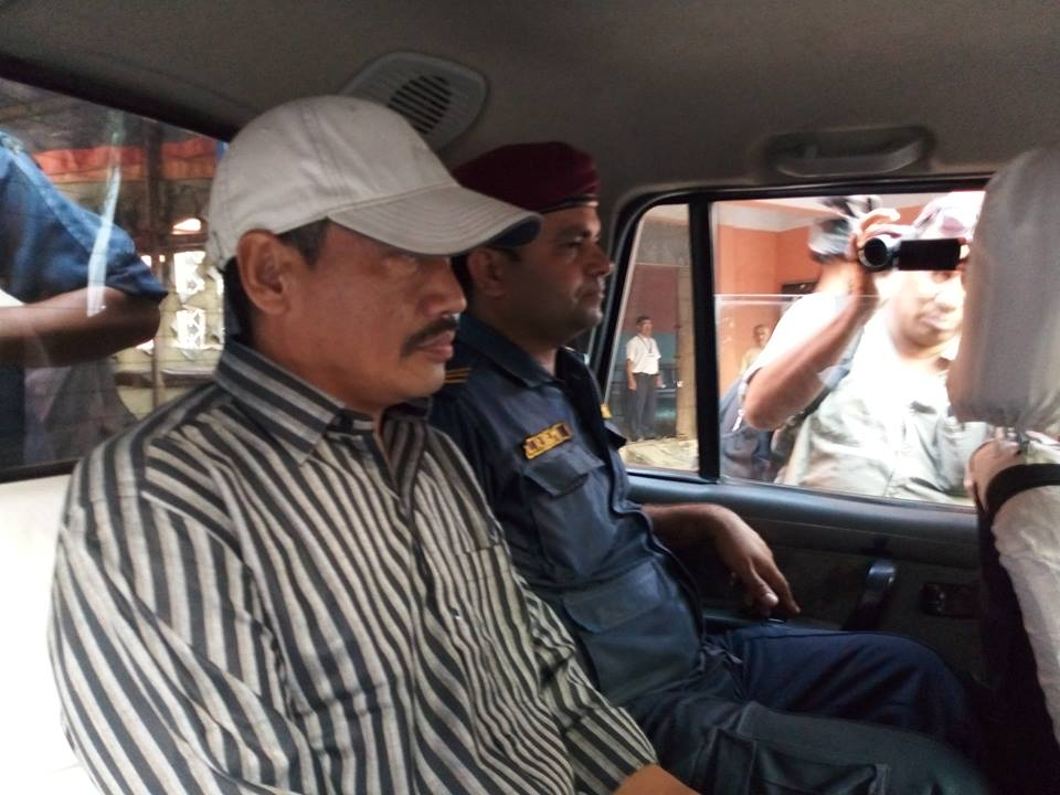 Police take Tsering Wangdel Ghale, one of the prime accused in the infamous gold smuggling and murder case in judicial custody following a trial hearing at District Court, Morang on June 3, 2018. Photo: Hari Adhikari