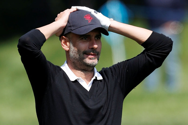 Golf - European Tour - BMW PGA Championship - Wentworth Club, Virginia Water, Britain - May 23, 2018   Manchester City manager Pep Guardiola reacts during the pro-am   Action Images via Reuters/Paul Childs