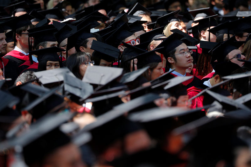 Students attend the 367th Commencement Exercises at Harvard University in Cambridge, Massachusetts, U.S., May 24, 2018.   REUTERS/Brian Snyder