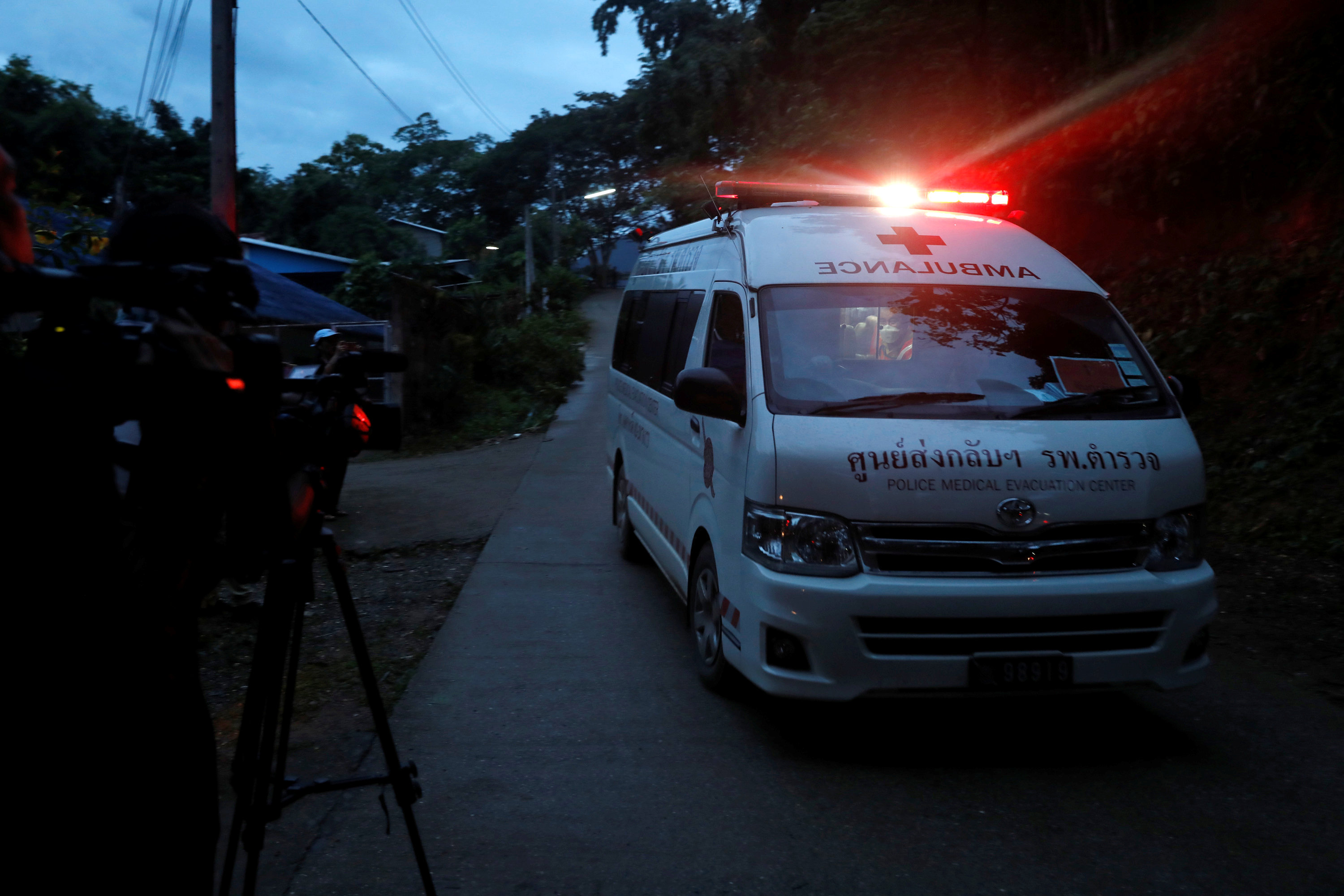 Journalists film an ambulance believed to be carrying rescued schoolboys as it travels to a military helipad near Tham Luang cave complex in the northern province of Chiang Rai, Thailand, July 8, 2018.  Photo: REUTERS