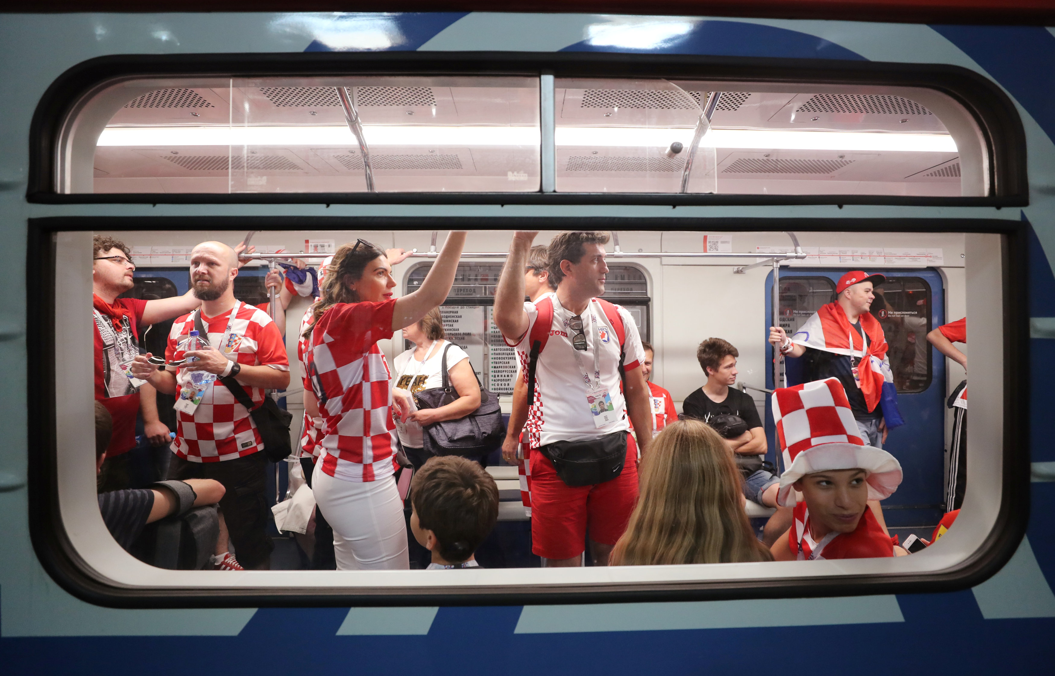 Soccer Football - World Cup - Final - France v Croatia - Moscow, Russia - July 15, 2018  Croatia fans make their way to the Luzhniki Stadium on the metro.   Photo: REUTERS