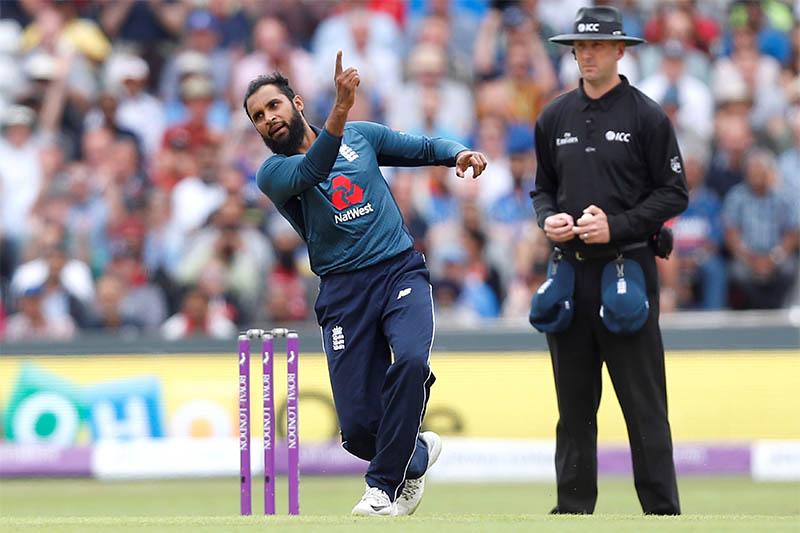 England's Adil Rashid celebrates taking a wicket. Photo: Reuters