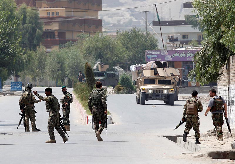 Afghan National Army (ANA) soldiers arrive at the site of gunfire and attack in Jalalabad city, Afghanistan, on July 11, 2018. Photo: Reuters