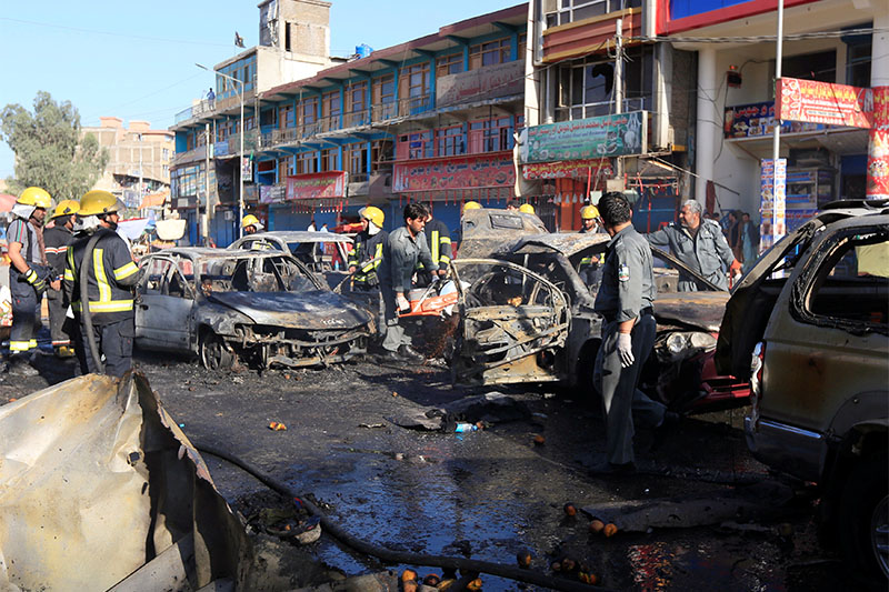 Afghan policemen inspect the site of a blast in Jalalabad city, Afghanistan, July 1, 2018. Photo: Reuters