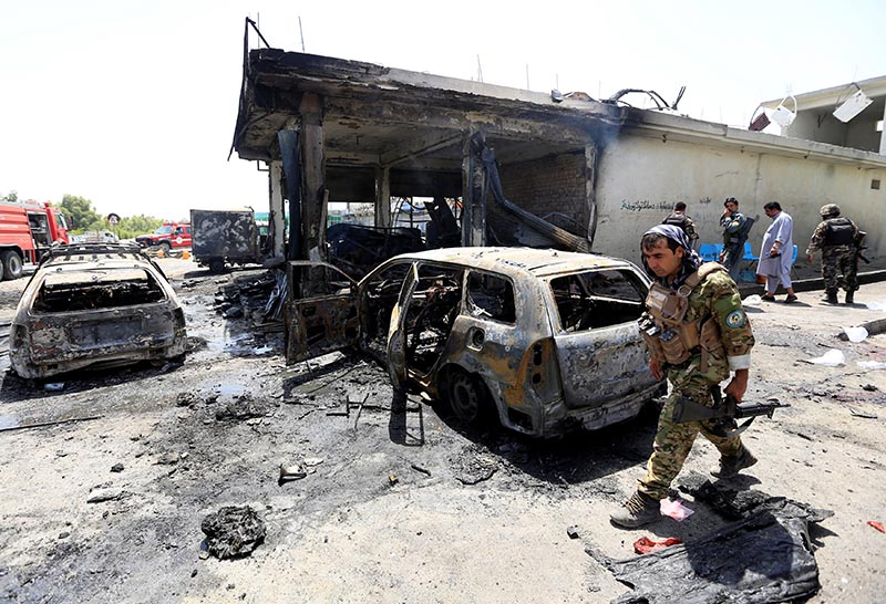 Afghan security forces inspect the site of a suicide attack in Jalalabad city, Afghanistan July 10, 2018. Photo: Reuters