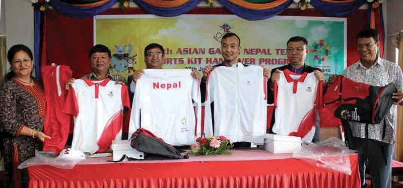 Nepal Olympic Committee officials and representatives of Agility Health and Wellness Cooperation displaying the 18th Asian Games squad sportswear during the handover programme in Lalitpur on Friday, July 27, 2018. Photo: THT