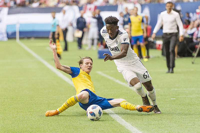 File: Vancouver Whitecaps forward Alphonso Davies (67) takes the ball up field during the second half after getting past Colorado Rapids forward Joe Mason (10) at BC Place. Mandatory Credit: Troy Wayrynen-USA TODAY Sports