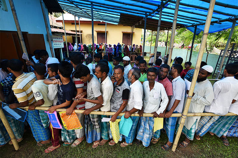 People wait in queue to check their names on the draft list at the National Register of Citizens (NRC) centre at a village in Nagaon district, Assam state, India, July 30, 2018. Photo: Reuters