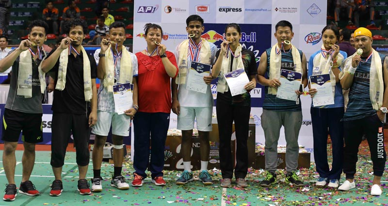 APFu0092s Dipesh Dhami (centre) celebrates on the podium after winning the menu0092s single title of the AnnapurnanInternational Corporate Badminton on Saturday, July 28, 2018. Photo: THT