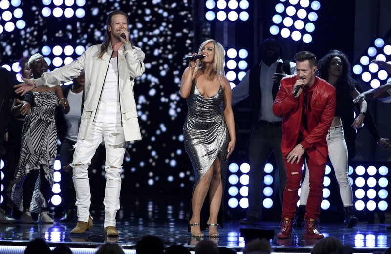 File - In this photo, Tyler Hubbard, right, and Brian Kelley, left, of Florida Georgia Line, and Bebe Rexha, center, perform u201cMeant to Beu201d at the 53rd annual Academy of Country Music Awards in Las Vegas on April 15, 2018. Photo: AP
