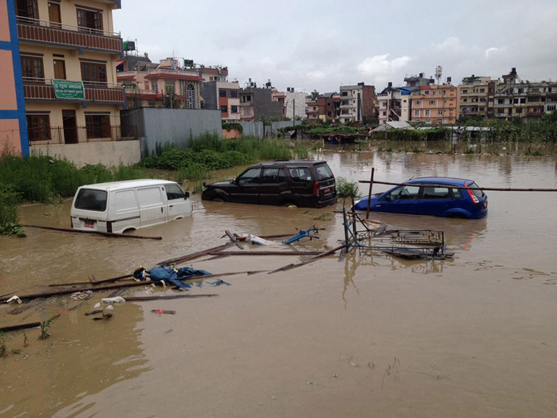 Vehicles partially submerged in a pool of water after incessant rainfall caused inundation in Bhaktapur, on Thursday, July 12, 2018. Photo: Ujjwal Satyal/THT