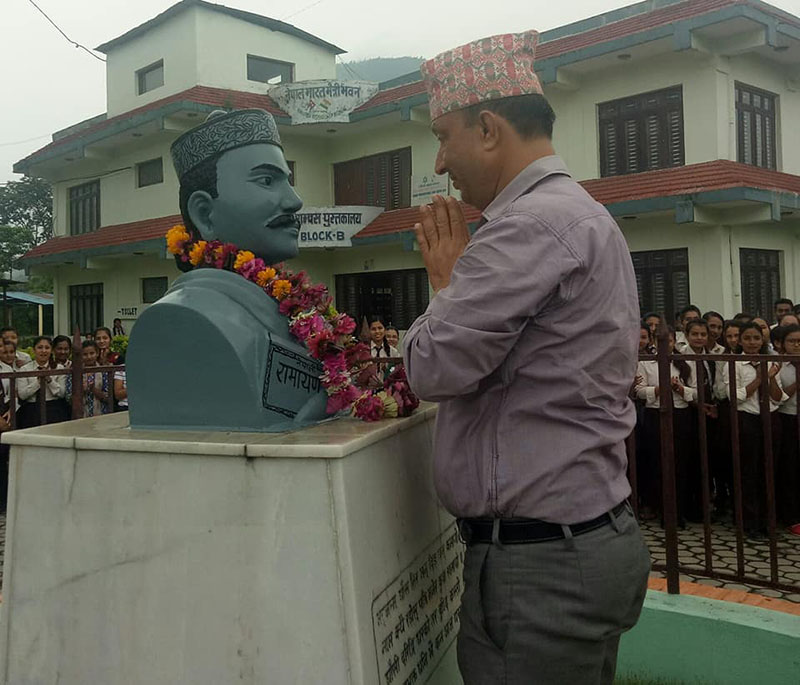 Chief of the District Coordination Committee, Shanti Raman Wagle, paying a floral tribute to the statue of Bhanubhakta Acharya amid a programme, marking the 205th birth anniversary of the pioneer poet of Nepal, at Damauli-based Aadikavi Bhanubhakta Campus, in Tanahun, on Friday, July 13, 2018. Photo: Madan Wagle