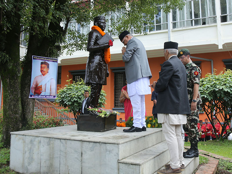 Prime Minister KP Sharma Oli paying a floral tribute to the statue of Aadikavi Bhanubhakta Acharya on the occasion of the pioneer poet's 205th birth anniversary, at Nepal Academy, in Kathmandu, on Friday, July 13, 2018. Photo: RSS