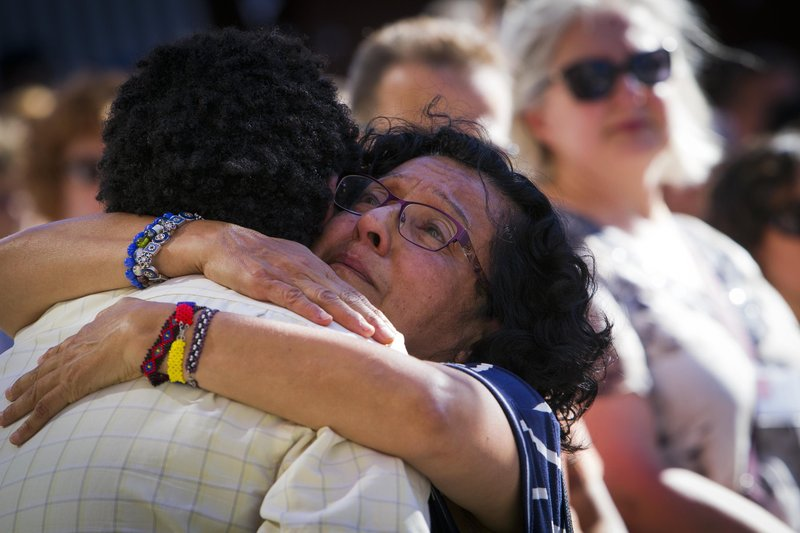 Lila Cabrera, who teaches English to refugees, hugs Kibrom Milash, after his comments to a crowd of people, as they gathered for a vigil at City Hall in Boise, Idaho, on Monday, July 2, 2018. Photo: AP