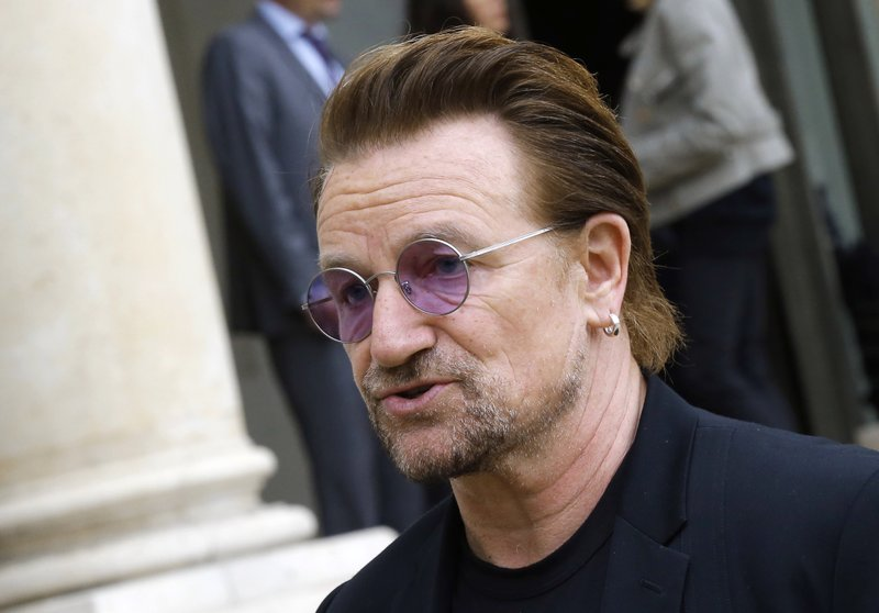 File - In this photo, founder of the non-governmental organization ONE, U2 singer Bono speaks to the media after a meeting at the Elysee Palace, in Paris on Monday, July 24, 2017. Photo: AP