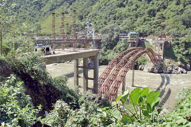 An under-construction 160 metre arch bridge over Trishuli river connecting Tanahun and Chitwan districts along Prithvi Highway in Muglin, on Monday, July 2, 2018. Photo: Madan Wagle