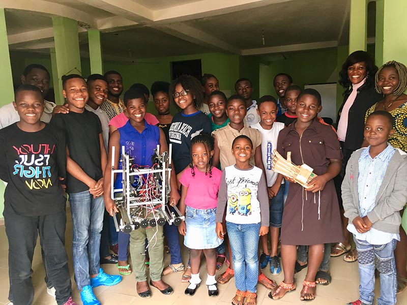 Janet Fofang and the children and youths taking part in NextGen technical skills workshop in Yaounde, Cameroon, on July 11, 2018. Photo: Thomson Reuters Foundation
