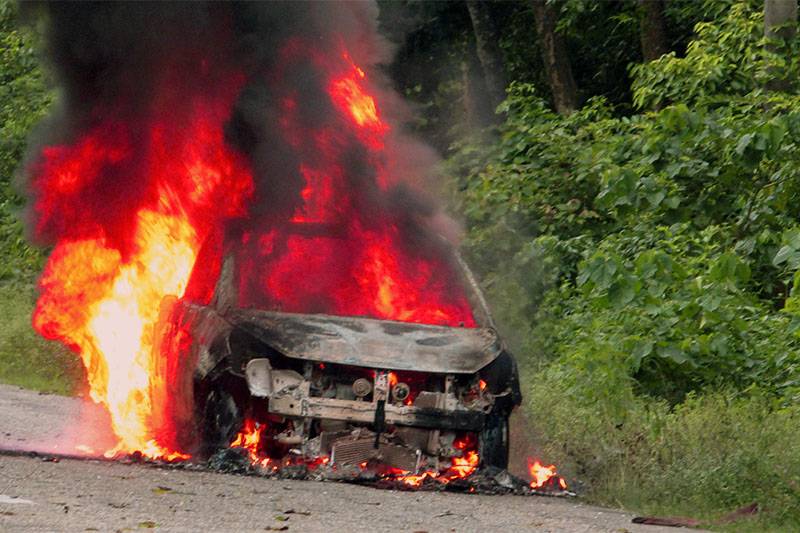 A car moving along the East-West Highway is seen engulfed in flames, on Friday, July 27 2018. Photo: Prabhat Kumar Jha/ THT