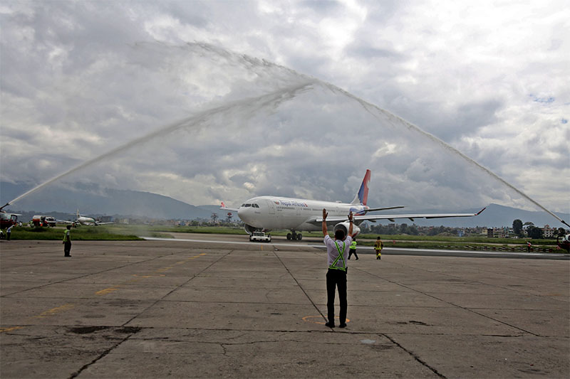 Nepal Airlines Corporation (NAC)'s second wide-body Airbus (A330-200) receives a ceremonial water-cannon salute after it touched down at TIA from Tolouse, France, on Thursday, July 26, 2018. Photo: RSS