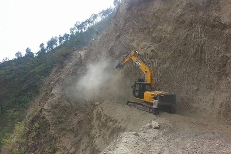 An excavator being used to construct a road in Champa Devi Rural Municipality, Okhaldhunga, on Wednesday, Juy 18, 2018. Photo: THT