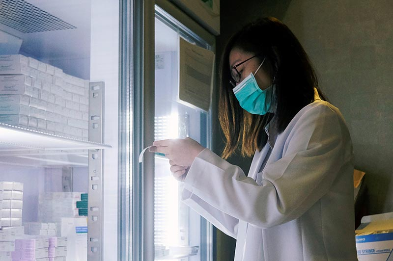 A nurse looks for vaccines at a children's clinic in Hong Kong, China, on  July 24, 2018. Photo: Reuters