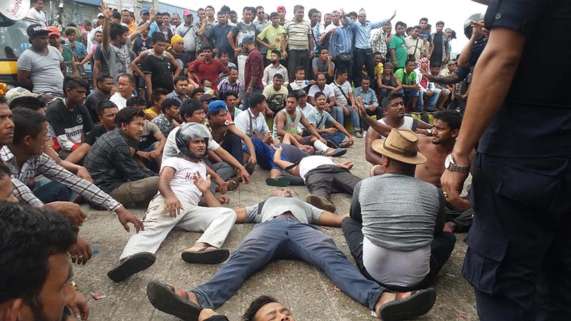 Agitating three-wheeler operators staging protest by sleeping on the road, in Bharatpur, Chitwan, on Wednesday, July 25, 2018. Photo: THT