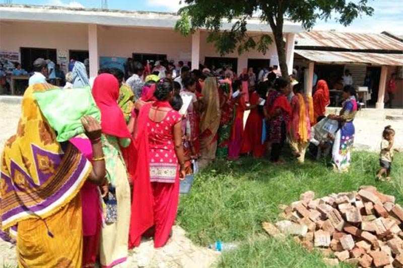 Locals lining up to receive citizenship cards at an integrated mobile camp in Golbazaar Municipality, Siraha, on Sunday, JUly 15, 2018. Photo: THT