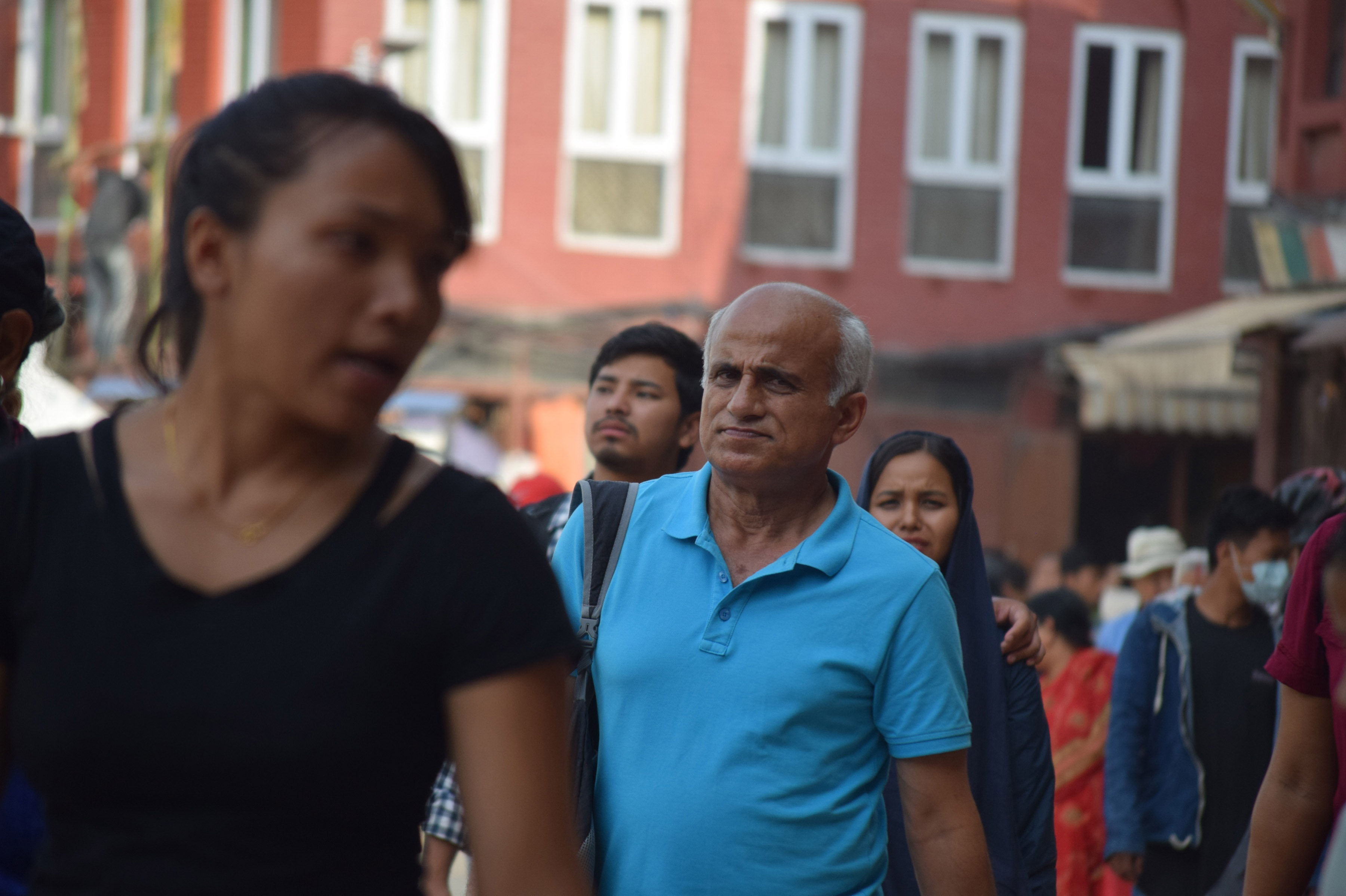 A stand out in the crowd: In this File Photo from June, 2018, Dr Govinda KC is seen walking around Boudha, Kathmandu as the photographer captures him without him knowing.n (Photo: Rabin Gautam)