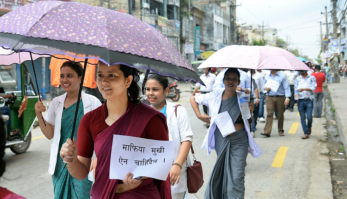 Health workers holding placards march on the streets of Birgunj, on Friday, July 13, 2018. Photo: Ram Sarraf