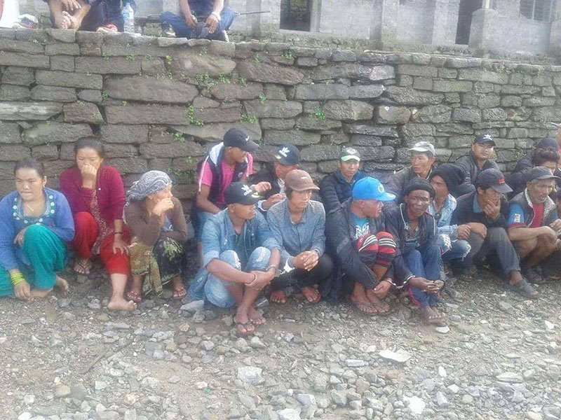 Detainees taken in police custody in connection with the murder of two 'jhankris' in Ganga Jamuna Rural Municipality, of Dhading district, on Tuesday, July 24, 2018. Photo: Keshav Adhikari
