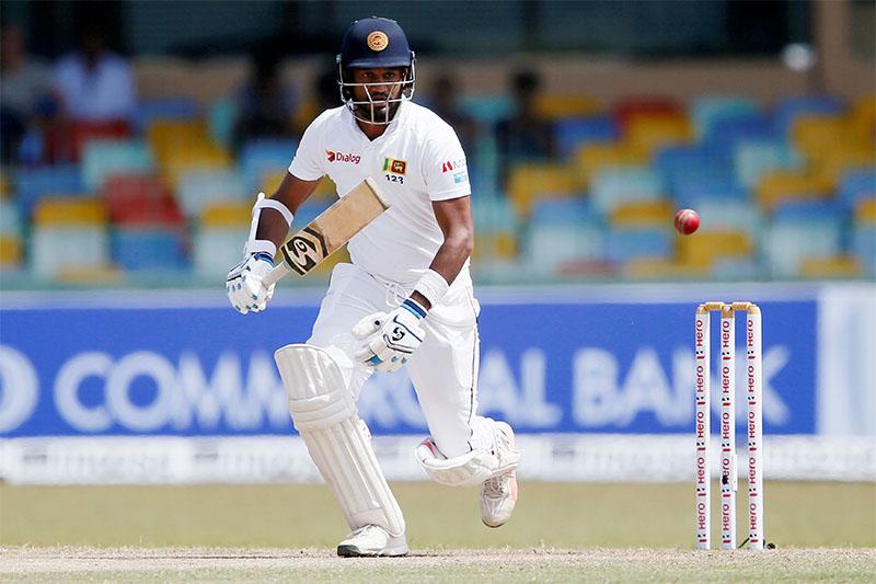 Sri Lanka's Dimuth Karunaratne watches his shot. Photo: Reuters